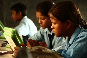 Students use laptops and digital resources provided by OLE Nepal