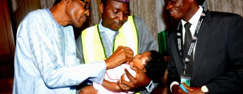 PIC 3. FROM LEFT: PRESIDENT MUHAMMADU BUHARI VACCINATING HIS THREE MONTHS OLD GRAND-DAUGHTER, ZULEIHA BELLO ABUBAKAR WITH ORAL POLIO VACCINE TO MARK ONE YEAR OF FREE POLIO CASE IN NIGERIA AT THE PRESIDENTIAL VILLA ABUJA ON SATURDAY (25/7/15). WITH HIM ARE: EXECUTIVE DIRECTOR, NATIONAL PRIMARY HEALTH CARE DEVELOPMENT AGENCY (NPHCDA) DR ADO MUHAMMAD AND THE INCIDENT MANAGER, POLIO EMERGENCY OPERATION ABUJA CENTRE, DR ANDREW ETSANO 028/JULY2015/ICE/STATE-HOUSE